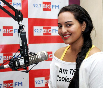 Sonakshi Sinha going live on air for listeners while promoting film ROWDY RATHORE at BIG FM Studios Photo