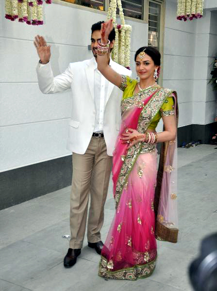 Esha Deol Bharat Takhtani waving at the assembled fans at their engagement ceremony Photo