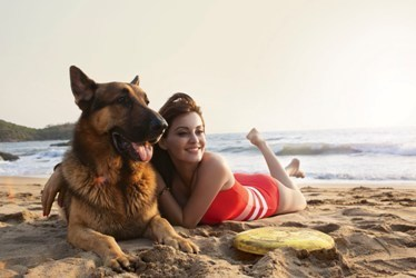 Minissha Lamba on beach with dog
