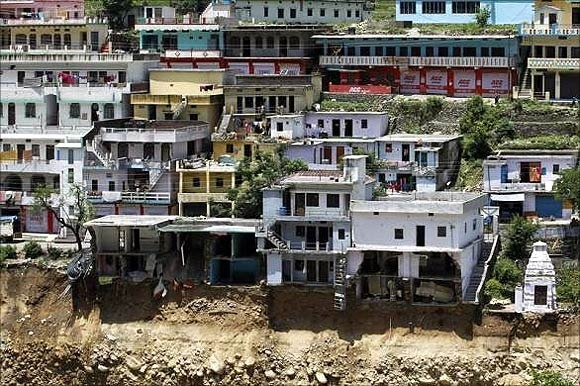 Damaged houses are seen at a village in Rudraprayag in Uttarakhand