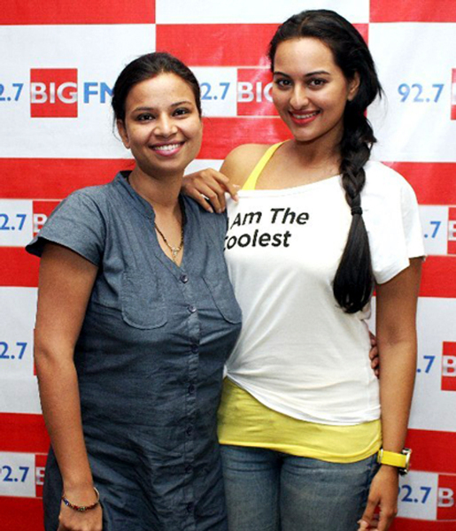 Sonakshi Sinha posing with RJ Rani while promoting film ROWDY RATHORE at BIG FM Studios in Mumbai photo